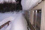 snow hanging off the roof and threatening the windows. Jan 5.